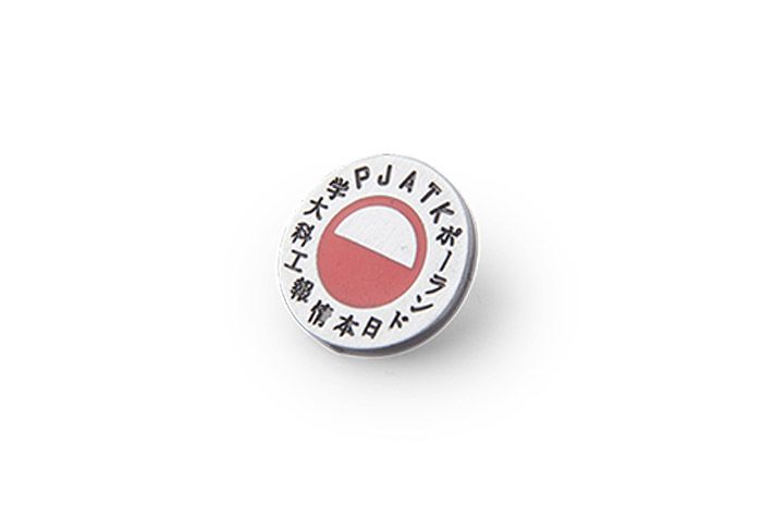 Metal pin with red element